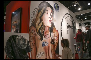LA Art Show opens in Los Angeles, California Street artists work on murals during the opening night of the LA Art Show in Los Angeles, California USa