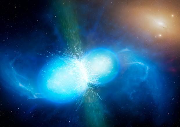 Rappresentazione artistica della collisione di due stelle di neutroni (fonte: University of Warwick/Mark Garlick) © Ansa