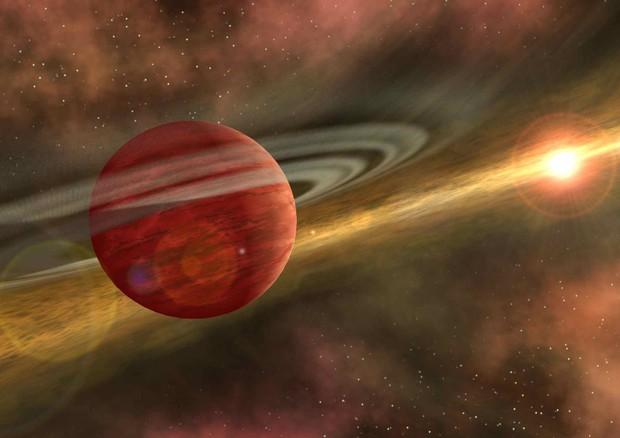 Una interpretazione artistica del momento in cui masse caotiche di gas e polveri cominciano ad aggregarsi per dare origine a un pianeta (fonte: NASA/JPL-Caltech) © Ansa