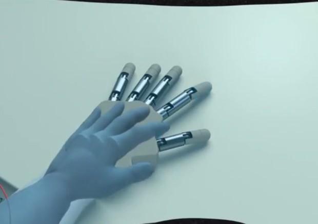Per la prima volta il cervello umano è riuscito a percepire una mano artificiale come se fosse la propria (fonte: Politecnico di Losanna (EPFL)) © Ansa
