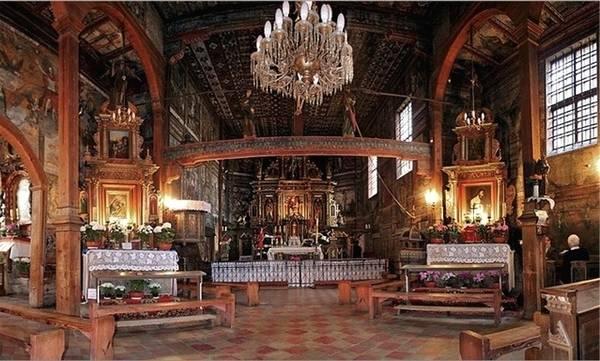 Polonia itinerario delle chiese in legno in viaggio for Case in legno in polonia
