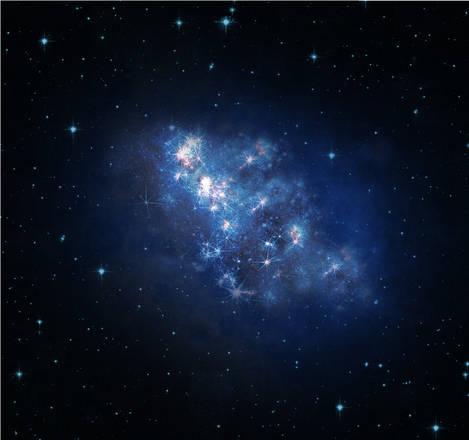 Una rappresentazione artistic di come potrebbe essere la galassia z8_GND_5296 (Foto: V. Tilvi, S.L. Finkelstein, C. Papovich, and the Hubble Heritage Team )
