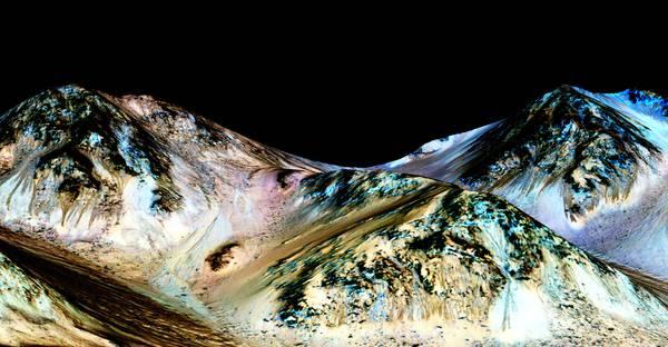 Le strisce scure sulla superficie di Marte sono la prova che sul pianeta scorre acqua, e che è salata (fonte: NASA/JPL/University of Arizona)