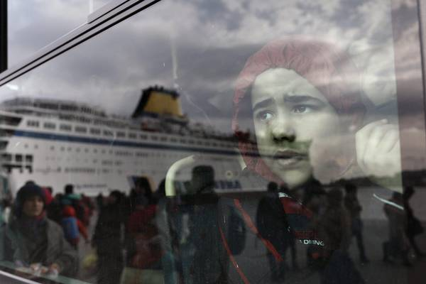 Refugees and migrants arrive at the port of Piraeus, near Athens