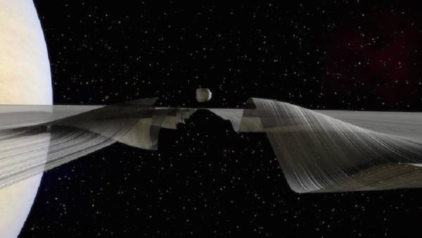 Una piccola luna increspa gli anelli di Saturno