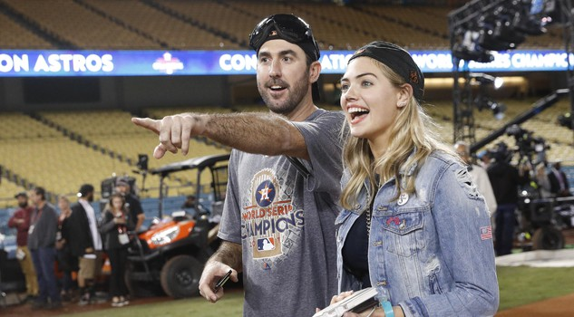 Houston Astros' Justin Verlander celebrates with Kate Upton after Game 7 of baseball's World Series against the Los Angeles Dodgers Wednesday, Nov. 1, 2017, in Los Angeles.