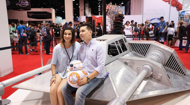 Disney fans pose with a snowspeeder movie prop from the Star Wars films during the D23 Expo in Anaheim, California, USA, 15 July 2017. The fan event focuses its activities around the Disney, Star Wars and their Marvel franchises.