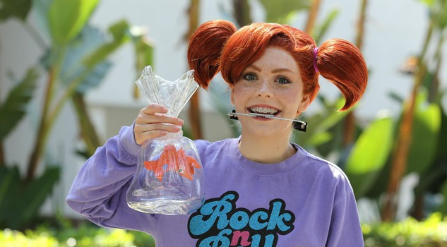 A Disney fan poses in her Darla cosplay outfit from the movie Finding Nemo during the D23 Expo in Anaheim, California, USA, 15 July 2017. The fan event focuses its activities around the Disney, Star Wars and their Marvel franchise