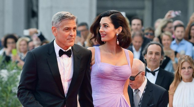 US film director George Clooney with his wife Amal Alamuddin Clooney arrive for the premiere of 'Suburbicon' during the 74th Venice Film Festival in Venice,
