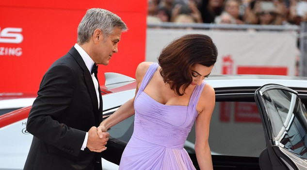 US film director George Clooney with his wife Amal Alamuddin Clooney arrive for the premiere of 'Suburbicon' during the 74th Venice Film Festival in Venice