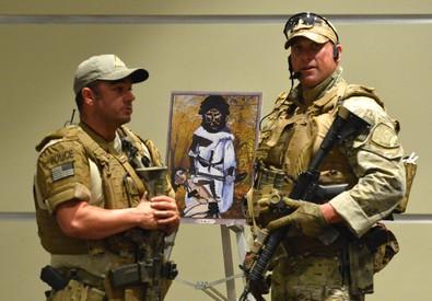 Poliziotti nella sede della mostra dove era in corso un evento dedicato a vignette raffiguranti Maometto (ANSA)
