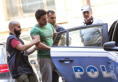 Il presunto stupratore di Prati, viene trasferito in carcere dalla questura di Roma (ANSA)