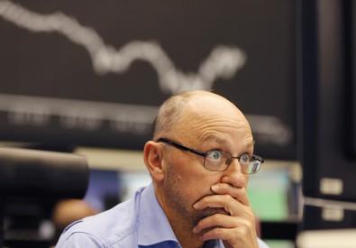 Un operatore di Borsa (ANSA)