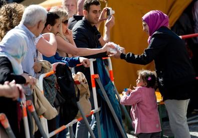 Rifugiati alla stazione di Monaco (ANSA)