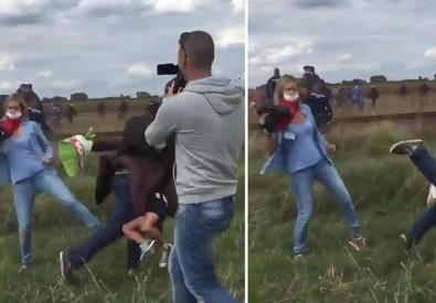 Reporter tv Ungheria sgambetta migranti (ANSA)