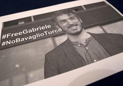 La foto di Gabriele Del Grande durante il congresso della  federazione nazionale di stampa italiana (ANSA)