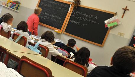 Una classe di una scuola elementare in una foto di archivio © ANSA