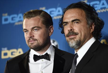 Alejandro Gonzalez Inarritu (D) junto a Leonardo DiCaprio (ANSA)