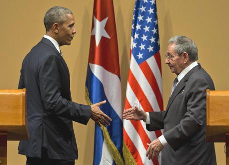 Barack Obama e Raul Castro © AP