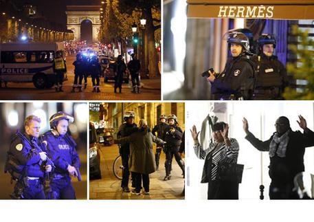 Attacco alla polizia agli Champs-Elyses di Parigi © ANSA