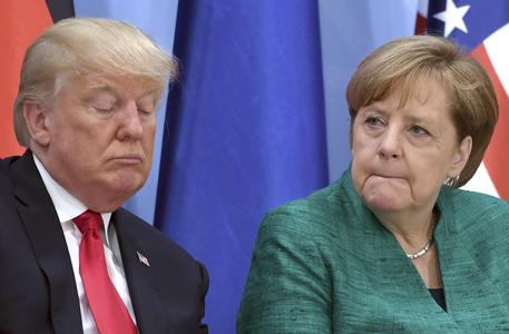 Donald Trump e Angela Merkel © AP