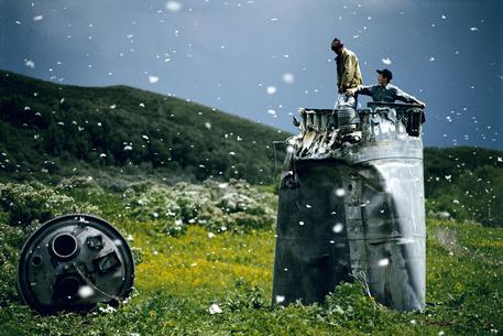 Magnum Manifesto. RUSSIA. Altai Territory. 2000. Villagers collecting scrap from a crashed spacecraft, surrounded by thousands of white butterflies. Environmentalists fear for the region's future due to the toxic rocket fuel. © ANSA