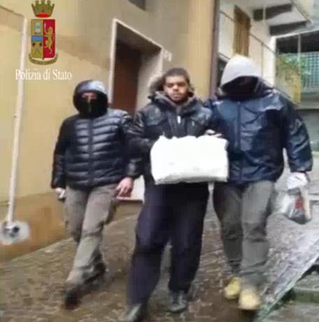 Un fermo immagine tratto da un video della Polizia mostra il 23enne Italo marocchino Elmahdi Halili arrestato a Torino per terrorismo © ANSA