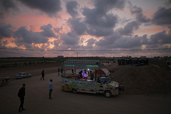 Palestinians gather along the Gaza Strip border