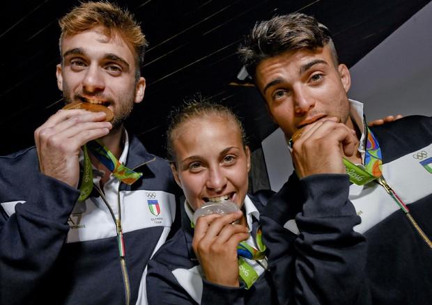 Le due medaglie d'oro, Fabio Basile (judo) e Daniele Garozzo (fioretto), l'argento di Odette Giuffrida (foto: ANSA)