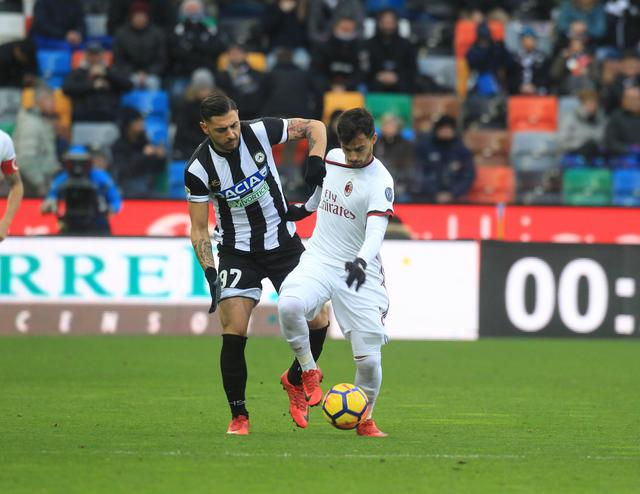 Italy serie A soccer match Udinese vs Milan- Udinese's Giuseppe Pezzella  and Milans Suso in action during the Italian Serie A soccer match Udinese vs Milan at Friuli Stadium in Udine Italy 4 february 2018