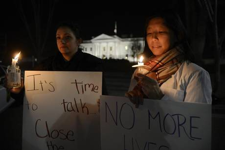 Supporters of gun control hold a candlelight vigil for victims of the Sandy Hook Elementary School shooting