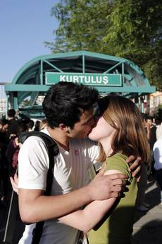 Turkish demonstrators kiss each other to protest moral warnings at subway stations