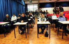Migrants sit first compulsory Italian tests