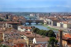 Woman cleans Ponte Vecchio after writing with nail polish