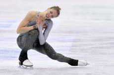 Ice skating: Kostner says she'll carry on to Olympics