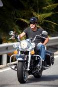George Clooney risks injury, sets bad example with 'old' helmet