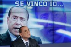 Berlusconi says his coalition has taken the lead