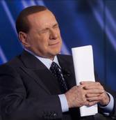 Berlusconi may have to stay overnight in hospital