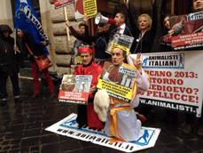 Animal rights activists protest against new pope's clothing