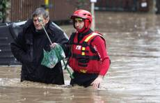 Woman in labour taken from flooded Rome home in dinghy