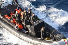 Navy saves dinghy with 100 migrants aboard