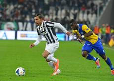 Soccer: Tevez strikes twice as Juve continue title charge