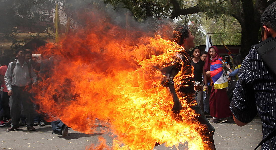 A Tibetan exile runs as he set fire to himself in New Delhi during a protest 2012 © EPA