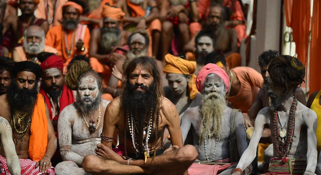 Sadhu or holy men perform yoga on the occasion of fifth International Yoga Day in Guwahati © EPA