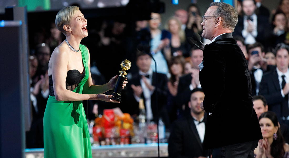 Ceremony - 77th Golden Globe Awards:  Charlize Theron presenting the Cecil B. DeMille Award to Tom Hanks © EPA