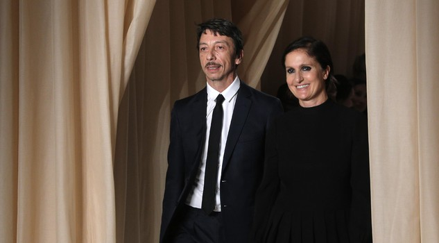 Italian creative directors Maria Grazia Chiuri, right, and Pier Paolo Piccioli acknowledge applause after the Valentino's Spring-Summer 2015 Haute Couture fashion collection presented in Paris