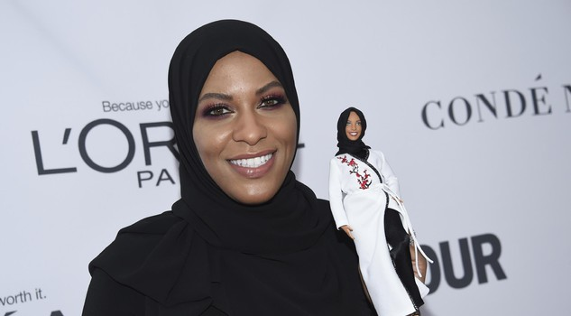 Ibtihaj Muhammad holds a Barbie doll in her likeness at the 2017 Glamour Women of the Year Awards at Kings Theatre on Monday, Nov. 13, 2017, in New York.