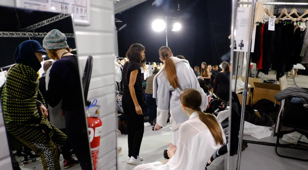 n this March 8 2015 file photo, models wait backstage before the presentation of Kenzo's ready-to-wear Fall-Winter 2015/2016 collection, during the Paris Fashion Week in Paris