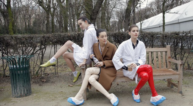In this Jan.26 2015 file photo, models take a rest backstage after the Christian Dior's Spring-Summer 2015 Haute Couture fashion collection presented in Paris.