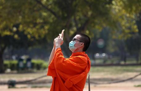 Turista con la mascherina © EPA